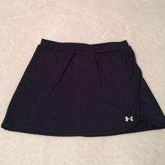 Navy blue Under Armout athletic skirt This is a skort, a skirt with built in shorts. Worn a few times, in excellent condition! Size small. Under Armour Skirts