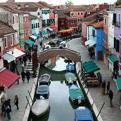 Burano island is known for its hand-knitted laces and colored houses. Their colors were to facilitate returning with the catch to fishermen finding a home in the fog.  View from  the roof top restaurant Riva Rosa  #Italia  #venice #travel (w: Island of Burano, Italy)