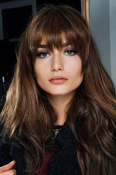 Hairstyles for long thick hair- Long, eyebrow-grazing bangs are versatile and flattering on almost everyone.