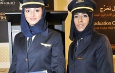 Etihad Airways' first female UAE national cadet pilots, Aisha al-Mansouri (L) and Salma al-Baloushi, after their graduation from flight school. (Gulf News)  http://al-shorfa.com/en_GB/articles/meii/features/2009/10/27/feature-03