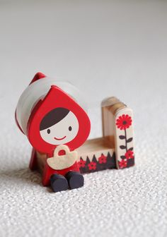 "The Better To Stick To You Tape Dispenser 17.99 at shopruche.com. Add whimsical appeal to your office space with this little red riding hood tape dispenser. Her charm will definitely keep you smiling.2.5""L x 3""H x 1.25""W"