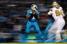 Cam Newton Photos Photos - Cam Newton #1 of the Carolina Panthers drops back to pass against the New Orleans Saints at Bank of America Stadium on November 17, 2016 in Charlotte, North Carolina. - New Orleans Saints v Carolina Panthers