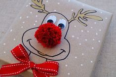 This cute Christmas Reindeer gift wrapping idea is really simple to do. - This cute Christmas Reindeer gift wrapping idea is really simple to do. For more ideas visit our bl - Valentine Gifts For Kids, Easy Diy Christmas Gifts, Christmas Crafts For Kids To Make, Christmas Gift Wrapping, Simple Christmas, Xmas Gifts, Christmas Decorations, Reindeer Christmas, Christmas Presents To Make