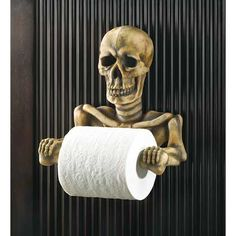 Kitschy Man Cave Decor: Skeleton Toilet Paper Holder.