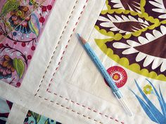 from Stitched in Color - hand-quilting tips - she likes to use a number 8 pearl cotton....  I think I may just try this!