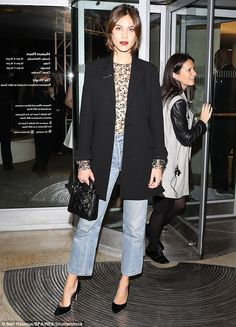 Racy! The British model, 33, went braless under a sheer lace blouse, teaming it with a smart blazer
