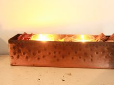 This is a beautiful vintage primitive copper long rectangular box. This rustic copper planter can add a touch of vintage charm to your home. This is a great holder for candles or potpourri. Measurements: 9 1/2 inches long  2 1/2 inches tall  2 1/2 deep  KLizVintage is a small shop so each customer receives individual attention. Feel free to message me with questions or comments.