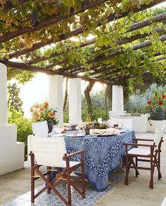 Grape leaf covered pergola. Such pretty outdoor seating.
