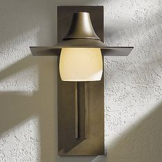 Distinctive outdoor lighting for the Asian-inspired landscape. Featuring a swooped pagoda-like cap, creamy hand-blown glass shade options and durable aluminum construction, the Hubbardton Forge Hood Outdoor Tall Wall Sconce with Glass combines earthy, elemental beauty with time-tested durability.