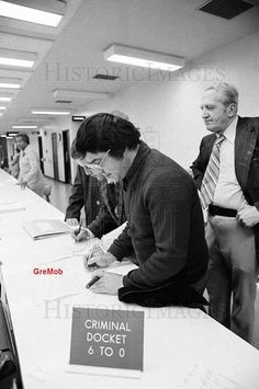 Joey Lombardo and Tony Spilotro signing their release forms. (Ross Stanger)