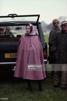 Queen Elizabeth II Wearing A Pink Cape At The Royal Windsor Horse Show