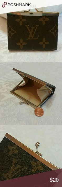 Vintage Tiny Coin Purse Cute tiny vintage coin purse from the 80's is brown on the outside and has a soft suede-like beige interior. Some tarnish and scratches on the gold parts. 3 1/4 inches wide X 2 1/2 inches tall and opens up 3 1/2 inches. NOT AUTHENTIC, just cute! Accessories Wallets