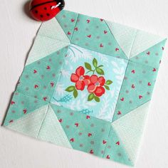 Block 102 - Hazel Sweetness.  Two different fabric ranges playing niccely together in my Paddles patchwork block.