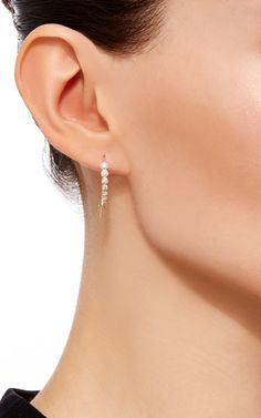 These **Jade Trau** earrings feature an exquisite design comprised of lavish diamonds which epitomizes the brand's modern, yet feminine aesthetic