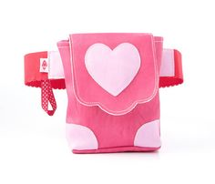 Follow Your Heart! #Inspire your little #girl (ages 4+) to always follow her heart and help promote independence with our fashionable & fun hands-free #bags! She'll love all the different ways to wear it: Style it around her waist, on her hips, bag in front or on the side!   Visit our page to see why this little #purse makes a great #gift! $29.99