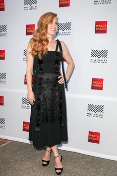 Actress Amy Adams poses for photos on the Mill Valley Film Festival red carpet at The Outdoor Art Club on October 6 2016 in Mill Valley California