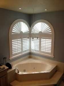 Our Louverwood Shutters With Arched Sunbursts On Corner Windows Over A Large  Garden Tub. What. Bathroom Window CoveringsBathroom ...