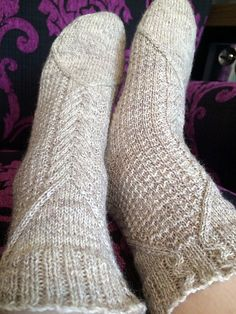 A cuff-down cabled sock designed originally to fit into the Cables category for Sock Knitters Anonymous September 2014 Challenge. Uses a 74 stitch leg and 64 stitch foot. Sizing can be adjusted by using heavier weight yarn and larger diameter needles.
