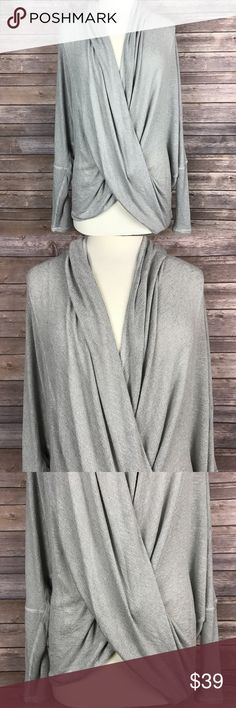 {Free People} Draped Front. Dropped shoulder. Dolman Sleeves. Pullover style. 73% rayon/ 24% polyester/ 3% spandex. RN# 66170. Condition: Excellent. Free People Tops Blouses