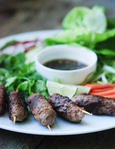 Vietnamese Pork Skewers — wrapped in lettuce leaves and garished with fresh herbs and thinly-sliced radishes, carrots and other vegetables, these grilled pork skewers make for a light but hearty meal, via @freshtartsteph