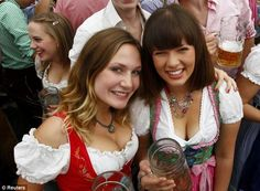 Old-school: The traditional drindl dress was a popular choice among young women at Oktoberfest Oktoberfest Outfit, Oktoberfest Beer, Austria, Drindl Dress, Beer Maid, Beer Girl, German Women, German Girls, Beer Festival