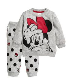 Set with top and joggers in sweatshirt fabric with a printed pattern. Top with snap fastener on one shoulder and ribbing at cuffs Little Girl Outfits, Cute Outfits For Kids, Toddler Girl Outfits, Boy Outfits, Baby Girl Fashion, Toddler Fashion, Kids Fashion, Stylish Toddler Girl, Disney Baby Clothes