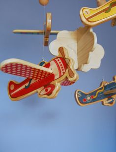 Love the idea of having it wood, so pretty.  Baby Mobile - Baby Crib Mobile - Wooden Vintage Airplanes - Airplane Nursery. $90.00, via Etsy.