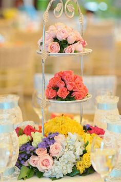For a French-inspired wedding, place dainty pastry racks with flowers in dreamy colors. | Flowers by Teddy Manuel | www.BridalBook.ph