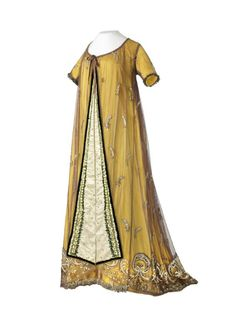 Dress, embroidered tulle on yellow silk underdress,  ca. 1810 From the Musée des Tissus et des Arts Décoratifs de Lyon