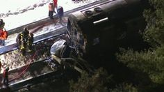 A commuter train has hit a vehicle at a level crossing north of New York City, killing at least seven people and injuring 12, officials say.  The train, with about 800 passengers on board, hit the Jeep Cherokee near Valhalla - about 20 miles (32km) from New York - on Tuesday evening.  The vehicle's female driver was killed, along with six people on the train, New York Governor Andrew Cuomo said.  The car and front carriage of the train caught fire following the crash.