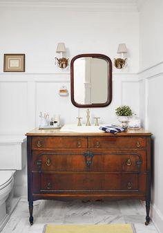 This master bath's vanity was replaced with a dresser reworked to accommodate a sink and sealed with Waterlox to withstand splashes.