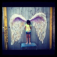 Interactive Angel wing graffiti by Colette Miller