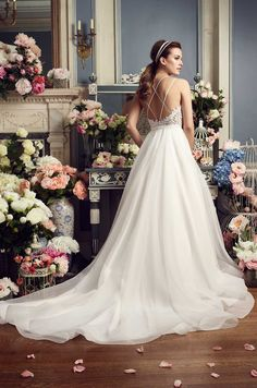 """@mikaellabridal   Style 2158, Guipure #Lace and #Organza #WeddingDress. Guipure Lace bodice with deep V-neckline and cross-over spaghetti straps. Bodice lined with Nude Italian Tulle. Full Organza skirt with pockets, finished with 4"""" horsehair edging at hem."""