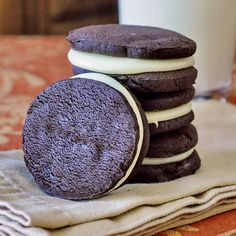 Homemade White Chocolate Fudge Oreos - building on the success of our homemade Fudgee-O recipe, here comes a Super Oreo! The white chocolate fudge filling is much better than traditional Oreo filling. The kids and their friends went crazy for these terrific sandwich cookies!