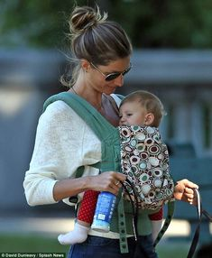 Baby onboard: Gisele Bundchen enjoyed a snuggly outing with daughter Vivian in Boston, Massachusetts on Thursday