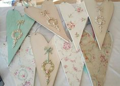 Coming to The Vintage Marketplace wooden hearts fabric applique pastels roses bows romantic wall art.