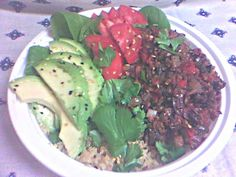 "My version of a Bhudda Bowl.  Quinoa, my homemade mushroom ""meat"" (taco style), and spinach topped with tomatoes, avocado, and cilantro. Served with a little of my nacho-style cashew cheez. DELISH!!!"