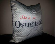 Shes so Ostentatious reversible throw pillow w/polka dot & houndstooth 16x16