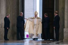 Pope Francis opens the Holy Doors.