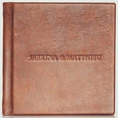 Embossed leather wedding photobook, handcrafted with care for professional photographers.