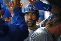 Welcome in the dugout:   Toronto Blue Jays right fielder Jose Bautista is congratulated in the dugout after he scored against the Tampa Bay Rays during the first inning at Tropicana Field in St. Petersburg, Fla., on April 3.  -       © Kim Klement/USA TODAY Sports