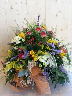 Centre primaveral, amb flors silvestres d'aromes delicats