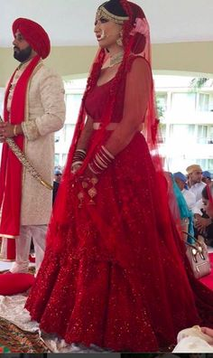 LOVE the colour of her lehenga!Here's a look at our breathtaking couple Aiyna and Harinder both dressed in stunning pieces designed by Congratulations Aiyna and Harinder! Wishing you both a lifetime of love and happiness ❤️ Sikh Wedding Dress, Indian Bridesmaid Dresses, Indian Wedding Gowns, Indian Bridal Outfits, Indian Bridal Lehenga, Indian Dresses, India Wedding, Red Lehenga, Punjabi Wedding