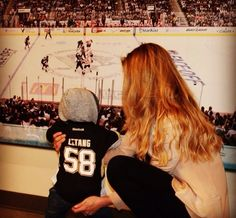 Kris Letang's son & wife<< I just love this. aww and he's got his daddy's shirt! too precious