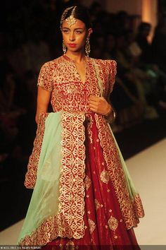 A model walks the ramp to showcase a creation by designer Meera Muzaffar Ali on Day 2 of the India Bridal Fashion Week (IBFW) 2013 at The Grand, Vasant Kunj in New Delhi