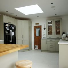 The Bianco De Lusso style quartz has been installed into this hub of the home. A beautiful choice of cabinetry and flooring really make the worktops stand out. The island at the back of the kitchen has been fitted with a wooden worktop to spice things up a bit and add some depth and different material to the kitchen space.