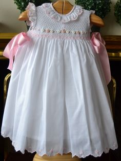 Related image Choosing children's baptismal dresses is definitely / has … Girls Smocked Dresses, Baby Girl Dresses, Vintage Baby Dresses, Little Girl Outfits, Kids Outfits, Fashion Kids, Smocking Baby, Baby Frocks Designs, Baby Dress Design