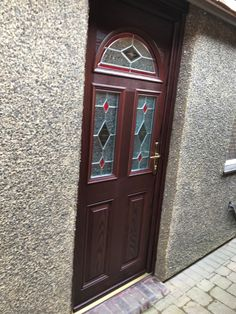 Rosewood composite front door with éclat arch and red accented sealed units supplied and installed by Unicorn Windows Ltd, Leighton Buzzard Windows, Composite Front Door, Windows And Doors, Red Accents, Bedfordshire, Front Door, Patio Doors, Doors