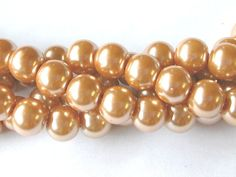 Light Bronze Pearls Bronze 10mm Glass Pearls by wimsy on Etsy (Craft Supplies & Tools, Jewelry & Beading Supplies, Beads, bronze pearls, glass pearls, 10mm pearls, 10mm glass pearls, 16 inch strand, full strand pearls, wimsy)
