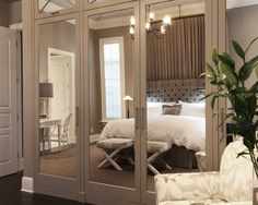 Mirror closet doors in bedroom ~ reflection | Wolfe and Rizor
